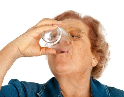 Staying hydrated as a senior citizen woman.