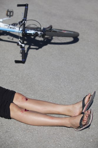 Woman that fell off a bike.