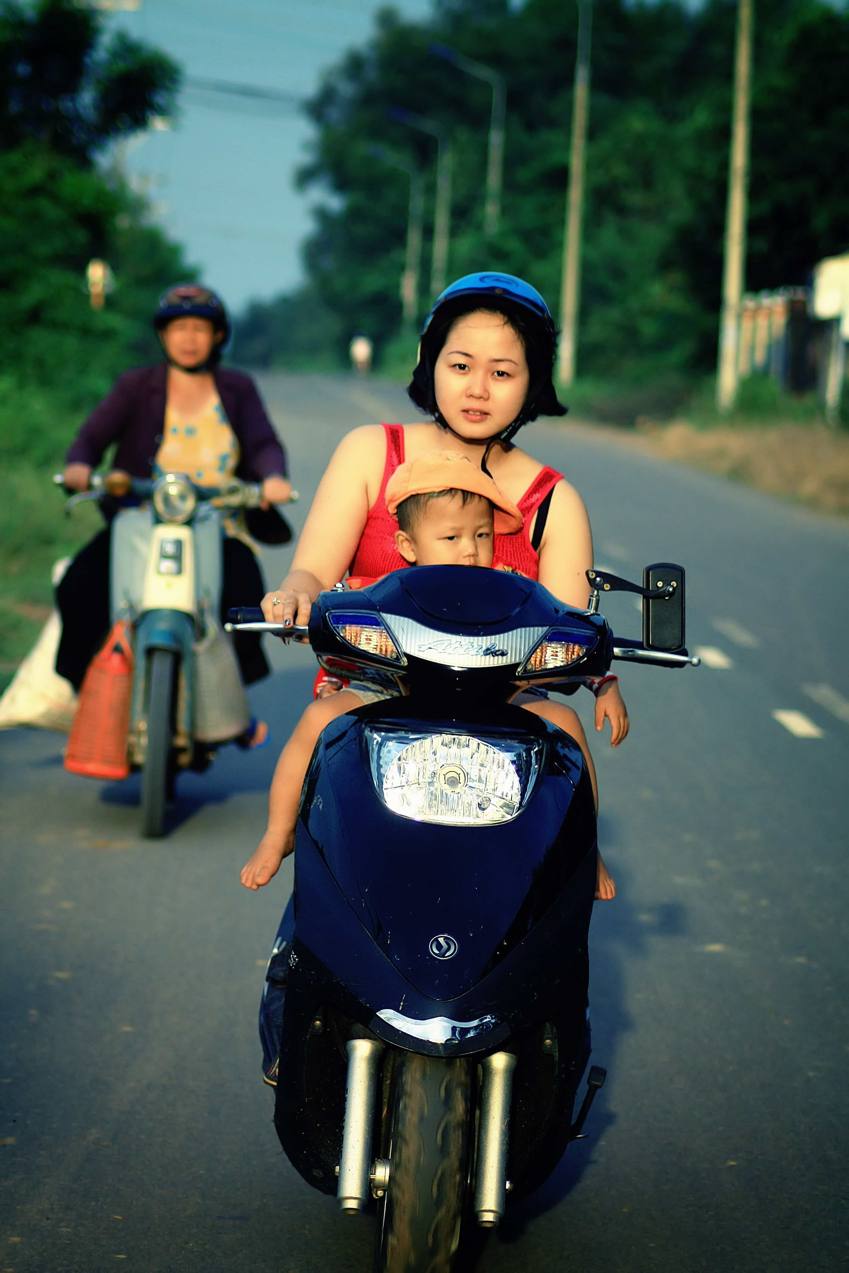 Child riding on front of a motorcycle picture.