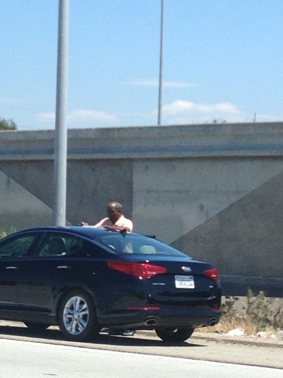 Man exchanging info after a car accident on LA Freeway