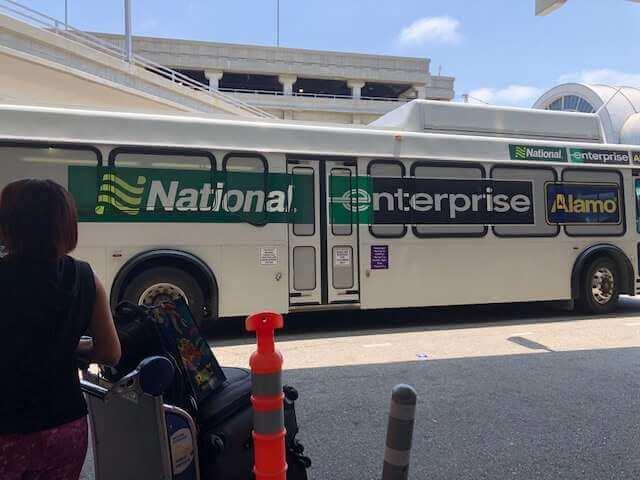 Pedestrians standing by Enterprise National Bus LAX